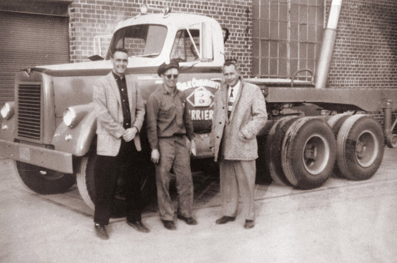 1958 –Pictured in the middle is Richard Johnson with one of his ten delivery trucks.