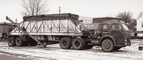 1955 - U.S. Salt puts its first hopper salt truck into service picking up product from Duluth, MN.